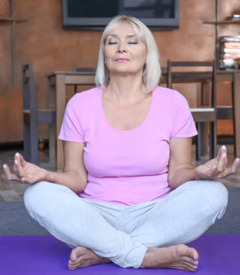 6 Tips For Seniors to Stay Busy While in Isolation, senior doing yoga