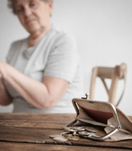 US Treasury Enacts CARES Stimulus Package to Support Struggling Americans, senior woman with coin purse